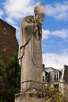 Staute of Saint Denis.  Place Susan Buisson, Montmartre, Paris.  Statue of decapitated, martyr Saint Denis, carrying his head.  Legend has it that after being decapitated by the Romans at the top of the hill, St. Denis went on to pick up his head, wash it off and carry it 8 kilometers (about 4 miles) to the north to what is now the town of St. Denis before he finally dropped.