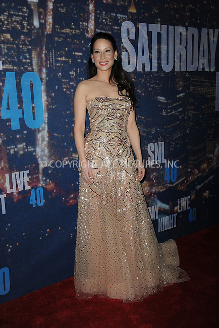 WWW.ACEPIXS.COM<br /> February 15, 2015 New York City<br /> <br /> Lucy Liu walking the red carpet at the SNL 40th Anniversary Special at 30 Rockefeller Plaza on February 15, 2015 in New York City.<br /> <br /> Please byline: Kristin Callahan/AcePictures<br /> <br /> ACEPIXS.COM<br /> <br /> Tel: (646) 769 0430<br /> e-mail: info@acepixs.com<br /> web: http://www.acepixs.com