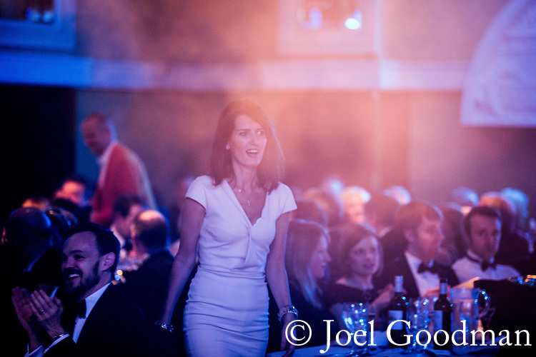 © Joel Goodman - 07973 332324 . 05/03/2015 .  Midland Hotel , Manchester , UK . Winner Karen Jackson of Roberts Jackson Solicitors walks to the stage to collect her award . Personal Injury / Clinical Negligence Team of the Year . The Manchester Legal Awards 2015 . Photo credit : Joel Goodman