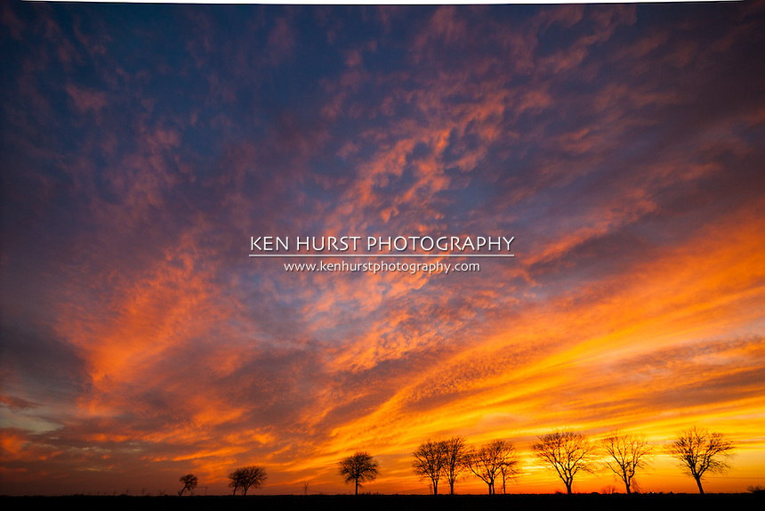 Extremely colorful sky at sunset on a late winter day in the North Texas area. Scene photographed in a rural area near the city of Palmer, Texas.