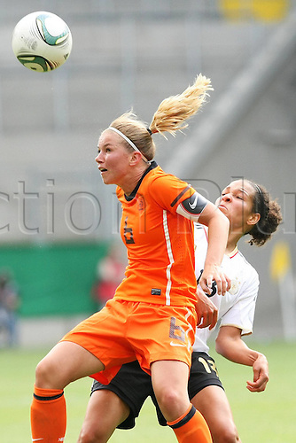 07 06 2011  Womens International Football. Germany versus Holland.  in Aachen.  Anouk Hoogendijk Netherlands beats Celia Okoyino Germany
