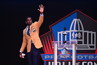 Canton, OH - August 4, 2018: Former NFL wide receiver  Randy Moss waves to the audience after giving his Pro Football Hall of Fame enshrinement speech at the Tom Benson Hall of Fame Stadium, August 4, 2018, in Canton, Ohio.  (Photo by Don Baxter/Media Images International)