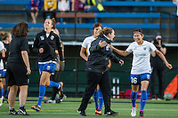 Seattle, Washington -  Sunday, September 11 2016: Seattle Reign FC head coach Laura Harvey greets Seattle Reign FC forward Nahomi Kawasumi (36) before a regular season National Women's Soccer League (NWSL) match between the Seattle Reign FC and the Washington Spirit at Memorial Stadium. Seattle won 2-0.