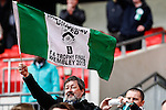 LONDON, ENGLAND - MARCH 29: A North Ferriby United fan celebrates victory in the FA Trophy over Wrexham after the FA Carlsberg Trophy between North Ferriby United and Wrexham at Wembley Stadium, London<br /> Picture by David Horn/eXtreme aperture photography +44 7545 970036<br /> 28/03/2015