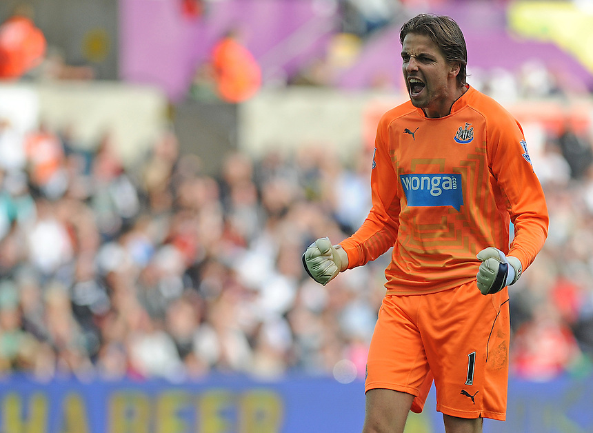 Newcastle United's Tim Krul celebrates his sides second goal scored by Papiss Demba Cisse (not in frame) <br /> <br /> Photographer Ashley Crowden/CameraSport<br /> <br /> Football - Barclays Premiership - Swansea City v Newcastle United - Saturday 04th October 2014 - Liberty Stadium - Swansea<br /> <br /> &copy; CameraSport - 43 Linden Ave. Countesthorpe. Leicester. England. LE8 5PG - Tel: +44 (0) 116 277 4147 - admin@camerasport.com - www.camerasport.com