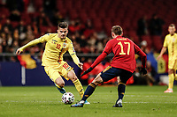 18th November 2019; Wanda Metropolitano Stadium, Madrid, Spain; European Championships 2020 Qualifier, Spain versus Romania;  Ianis Hagi (Romania) takes on Fabian of Spain - Editorial Use