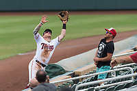 Salt River Rafters second baseman Travis Blankenhorn (5), of the Minnesota Twins organization, prepares to make a catch before falling into the stands during an Arizona Fall League game against the Surprise Saguaros at Salt River Fields at Talking Stick on October 23, 2018 in Scottsdale, Arizona. Salt River defeated Surprise 7-5 . (Zachary Lucy/Four Seam Images)