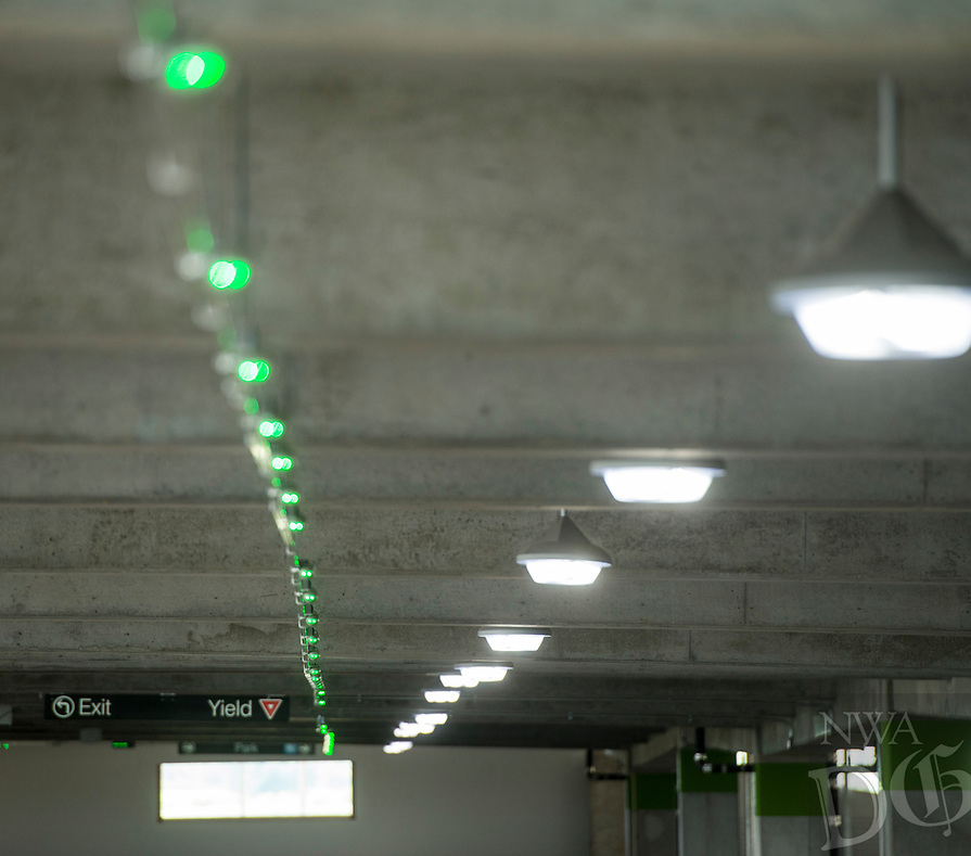 NWA Democrat-Gazette/BEN GOFF @NWABENGOFF<br /> Parking guidance system lights shine green for empty spots Wednesday, Aug. 8, 2018, in the new parking deck at Northwest Arkansas Regional Airport. The four-level deck with 1,110 spaces opened to the public at 10:00 a.m. today. It includes electric vehicle charging stations and a parking guidance system to help drivers find empty spaces. The lighs turn red when a vehicle occupies a space, and handicapped spots have blue lights.