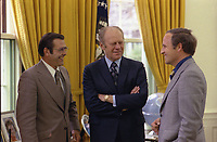 President Gerald R. Ford chatting with Chief of Staff Donald Rumsfeld and Rumsfeld's Assistant Richard Cheney in the Oval Office.  28 April 1975