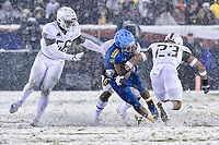 PHILADELPHIA, PA - DEC 9, 2017: Navy Midshipmen Quarterback Malcolm Perry (10) is tackled in open field by Army Black Knights defensive back Elijah Riley (23) during game between Army and Navy at Lincoln Financial Field Philadelphia, PA. Army defeated Navy 14-13 to win the Commander in Chief Cup. (Photo by Phil Peters/Media Images International)