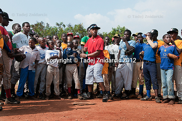 Ugandan baseball players listen during practice session lead by Philadelphia Phillies shorstop Jimmy Rollins at the sports field of St. Peter's school in Nsambya, neighbourhood of Kampala, Uganda on January 16 2012. During practice Rollins taught backhand, forehand, running and double-play.