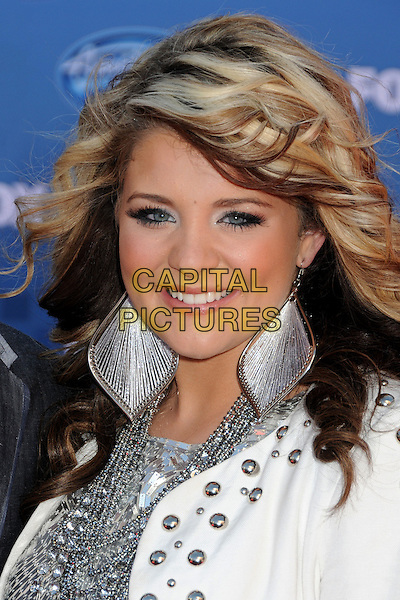 LAUREN ALAINA.Arrivals to the 2011 American Idol Finale held at The Nokia Live in Los Angeles, California, USA..May 25th, 2011.headshot portrait silver white jacket earrings smiling studs studded .CAP/ADM/BP.©Byron Purvis/AdMedia/Capital Pictures.