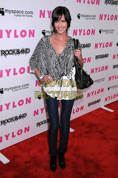 ODETTE YUSTMAN.Nylon Magazine and MySpace Celebrate their 3rd Annual Music Issue, Hollywood, California, USA..June 3rd, 2008.full length skinny jeans denim hand on hip black white pattern top wrap bag purse .CAP/ADM/BP.©Byron Purvis/AdMedia/Capital Pictures.