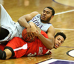 SIOUX FALLS, SD - DECEMBER 8:  Daniel Hurtt #15 from the University of Sioux Falls battles for the loose ball with Brandon Green #3 from Minot State Friday night at the Stewart Center. (Photo by Dave Eggen/Inertia)