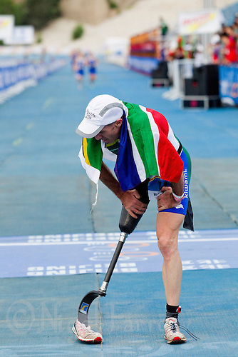 09 SEP 2011 - BEIJING, CHN - Oswald Kydd (RSA) wins the TRI-2 category at the 2011 ITU World Paratriathlon Championships .(PHOTO (C) NIGEL FARROW)