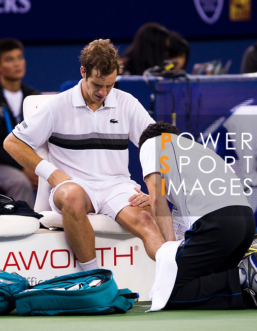SHANGHAI, CHINA - OCTOBER 14:  Richard Gasquet of France receives medical attention during his match against Novak Djokovic of Serbia during day four of the 2010 Shanghai Rolex Masters at the Shanghai Qi Zhong Tennis Center on October 14, 2010 in Shanghai, China.  (Photo by Victor Fraile/The Power of Sport Images) *** Local Caption *** Richard Gasquet