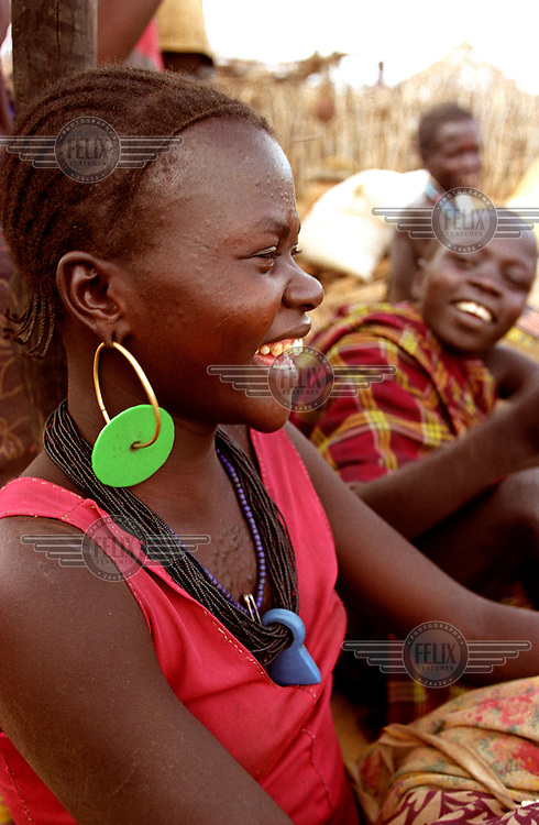 © Crispin Hughes / Panos Pictures..Uganda. Karamoja. Kotido district...Young Karamojong woman..The Karamojong are a cattle-herding, pastoralist people who live in semi-permanent settlements.