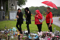Pictured: Mourners leave flowers after the burial at Thornhill Cemetery, Cardiff, Wales, UK. Tuesday 28 June 2016<br /> Re: The funeral of Sion, the baby boy found dead in the River Taff in Cardiff has taken place<br /> Generous locals raised nearly &pound;1,400 for the memorial after reading about plans to hold a fitting ceremony for the newborn baby whose body was discovered in Cardiff a year ago.<br /> The funeral took place at the Briwnant Chapel at Thornhill Crematorium, Cardiff. Members of the public are invited to be among the congregation.