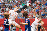 June 23, 2015: Vivianne MIEDEMA of Netherlands heads the ball during a round of 16 match between Japan and Netherlands at the FIFA Women's World Cup Canada 2015 at BC Place Stadium on 23 June 2015 in Vancouver, Canada. Japan won 2-1. Sydney Low/AsteriskImages.com