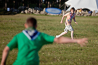 Two scouts playing with a frisbee during free activities.