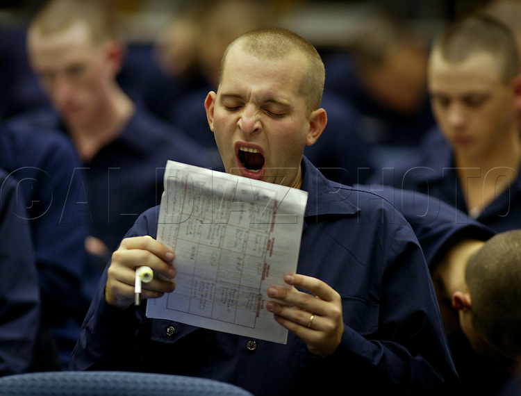 10/22/02--Al Diaz Photos--Boot Camp at The United States Coast Guard Training Center Cape May, NJ, on Tuesday. Christopher McDonald, 24, yawns during study period early Tuesday mourning.