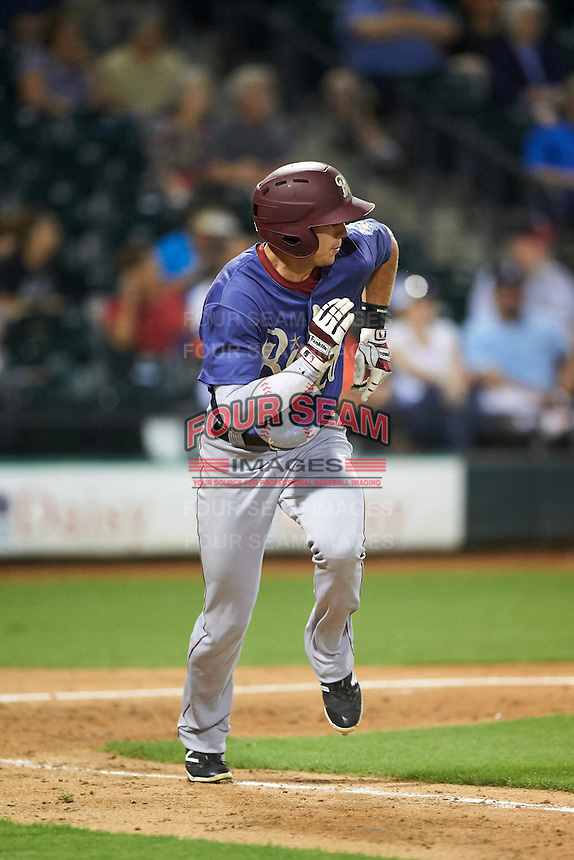 Frisco RoughRiders center fielder Ryan Cordell (20) runs to first during a game against the Corpus Christi Hooks on April 23, 2016 at Whataburger Field in Corpus Christi, Texas.  Corpus Christi defeated Frisco 3-2.  (Mike Janes/Four Seam Images)