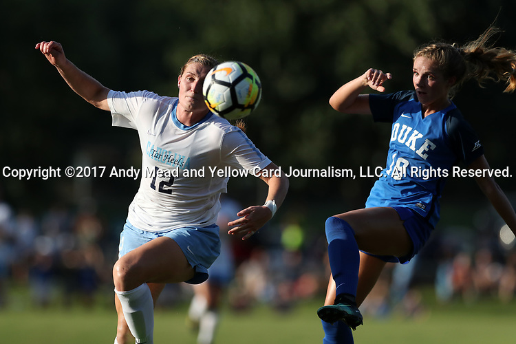 CARY, NC - AUGUST 18: North Carolina's Jessie Scarpa (12) and Duke's Schuyler DeBree (19). The University of North Carolina Tar Heels hosted the Duke University Blue Devils on August 18, 2017, at Koka Booth Stadium in Cary, NC in a Division I college soccer game.