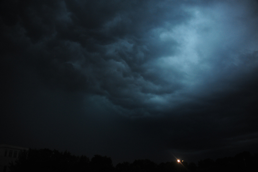 Jim Mendenhall Photos. Storm clouds with a cold front coming into a very warm front creating turbulence and lighting.