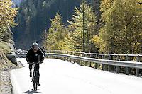 Un ciclista percorre una strada nel Parco Nazionale del Gran Paradiso, in Val d'Aosta.<br /> Scenic landscape with a cyclist along a road at the Gran Paradiso National Park in Aosta Valley.<br /> UPDATE IMAGES PRESS/Riccardo De Luca
