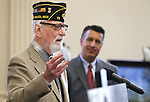 Gov. Brian Sandoval, rear, listens as Pearl Harbor survivor Charles Sehe speaks at the USS Nevada Centennial Ceremony at the Capitol in Carson City, Nev., on Friday, March 11, 2016. Sehe was serving on the USS Nevada when it was attacked at Pearl Harbor. Cathleen Allison/Las Vegas Review-Journal