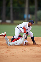Detroit Tigers shortstop Carlos Irigoyen (43) attempts to tag Hunter Markwardt (26) sliding into second base during an Instructional League game against the Philadelphia Phillies on September 19, 2019 at Tigertown in Lakeland, Florida.  (Mike Janes/Four Seam Images)