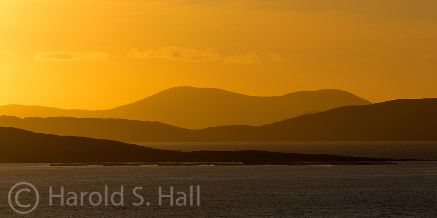 Allihies, Ireland is one of several very charming towns in the Ring of Beara peninsula and is one of over 800 towns vying to win the Tidy Town contest.  This is a sunset of the bay taken from the village.  Photos of these colorful towns are in the BLOG.