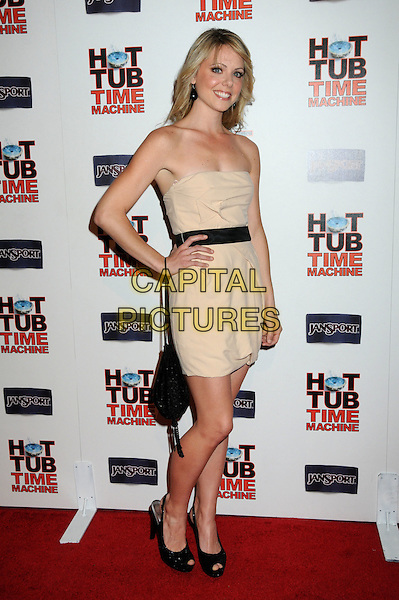"COLETTE WOLFE.""Hot Time Time Machine"" World Premiere Party held at the Cabana Club, Hollywood, California, USA..March 17th, 2010.full length dress hand on hip strapless beige cream black peep toe waistband bag purse hand on hip.CAP/ADM/BP.©Byron Purvis/AdMedia/Capital Pictures."