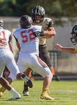 Palos Verdes, CA 09/25/15 - Terrell Williams (Lawndale #52) and Marcello Merola (Peninsula #8) in action during the Lawndale - Palos Verdes Peninsula Varsity football game at Peninsula High School.