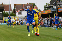Joe Pigott of AFC Wimbledon and. Jack Grimmer of Wycombe Wanderers during AFC Wimbledon vs Wycombe Wanderers, Sky Bet EFL League 1 Football at the Cherry Red Records Stadium on 31st August 2019
