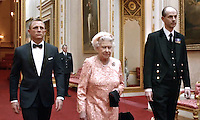 Queen Elisabeth II escorted by James Bond to the J.O. Ceremony