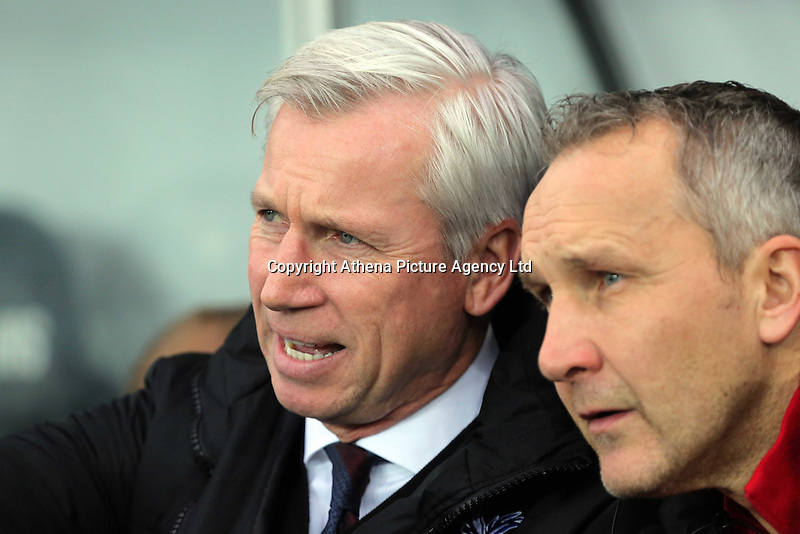 Crystal Palace manager Alan Pardew (L) during the Barclays Premier League match between Swansea City and Crystal Palace at the Liberty Stadium, Swansea on February 06 2016
