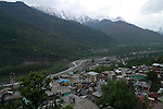 The original name for the Kullu valley was Kulantapith -the end of the habitable world.It is a narrow alpine valley drained by the Beas River and enclosed by the Pir Panjal to the north,the Bara Bangahal range to the west and the Parvati range to the east.This view is looking northwest over Vashisht and the River Beas towards the Solang Valley and the Rohtang Pass.