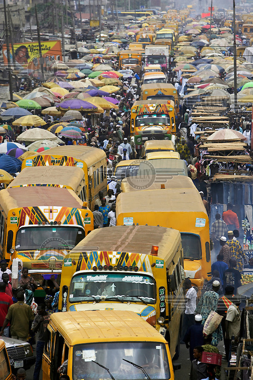 Buses and crowds of people in Oshodi market.