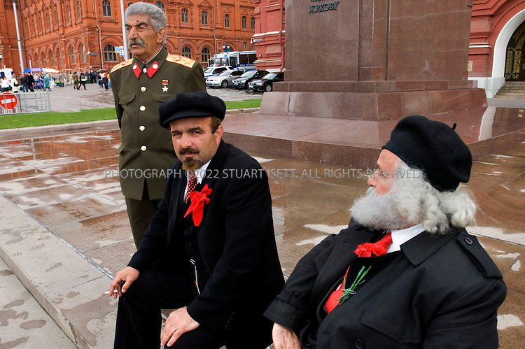 5/27/2006--Moscow, Russia..Stalin, Lenin and Marx impersonators take a break from posing with tourists near the Red Square in Moscow...Photograph By Stuart Isett.All photographs ©2006 Stuart Isett.All rights reserved.
