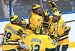 March 25,  2011             The University of Michigan Wolverines celebrate after they defeated the University of Nebraska -Omaha Mavericks in a sudden death overtime period 3-2, after regulation time ended with a 2-2 tie.  The officials took several minutes to make a ruling on a goal, which resulted in the Michigan team's win. They will advance after the win in the first semifinal game at the NCAA Division 1 Men's West Regional Hockey Tournament, played on Friday March 25, 2011 at the Scottrade Center in downtown St. Louis.