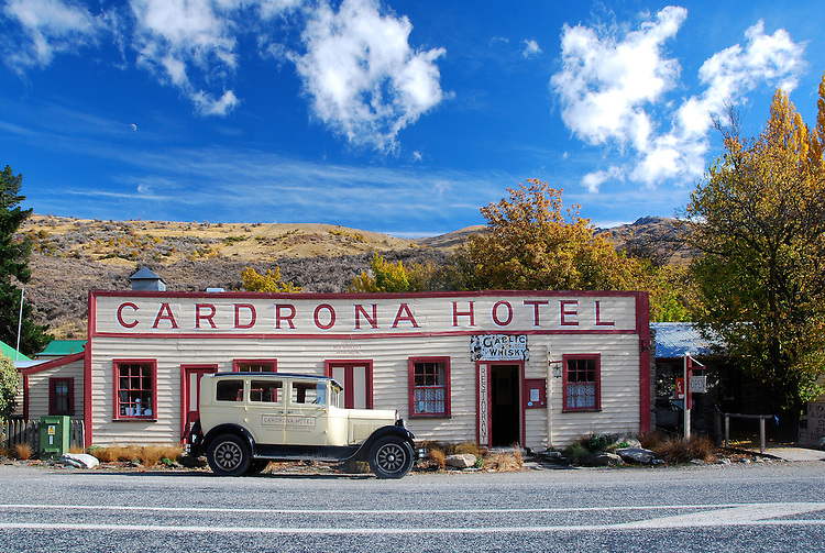 Vintage car parked outside the historic Cardrona Hotel on an Autumn afternoon, Central Otago, South Island, New Zealand - stock photo, canvas, fine art print
