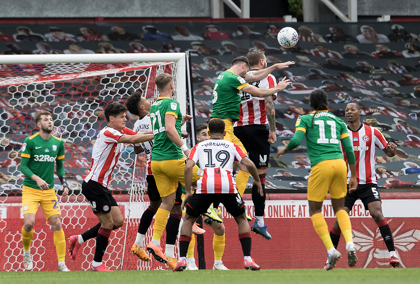 Preston North End's Andrew Hughes (centre) competing in the air<br /> <br /> Photographer Andrew Kearns/CameraSport<br /> <br /> The EFL Sky Bet Championship - Brentford v Preston North End - Wednesday 15th July 2020 - Griffin Park - Brentford <br /> <br /> World Copyright © 2020 CameraSport. All rights reserved. 43 Linden Ave. Countesthorpe. Leicester. England. LE8 5PG - Tel: +44 (0) 116 277 4147 - admin@camerasport.com - www.camerasport.com
