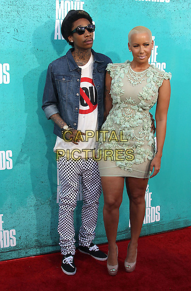 Wiz Khalifa & Amber Rose.2012 MTV Movie Awards held at the Gibson Amphitheatre, Universal City, California, USA..3rd June 2012.full length blue shirt check trousers hat sunglasses shades green lace dress couple.CAP/ADM/SLP/LS.©Lee Sherman/Starlitepics/AdMedia/CapitalPictures.