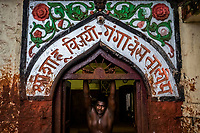 A Kushti wrestlers stretches after training at Gangavesh Talim on the 17th of September, 2017 in Kolhapur, India.  <br /> Photo Daniel Berehulak for Lumix