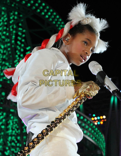 WILLOW SMITH .The Holiday Tree Lighting At L.A. Live & Opening Of L.A. Kings Holiday Ice held At L.A Live,  Los Angeles, CA, USA, .4th December 2010..music concert live on stage half length white red hair wig braids top gold fingerless gloves microphone singing side .CAP/ADM/KB.©Kevan Brooks/AdMedia/Capital Pictures.