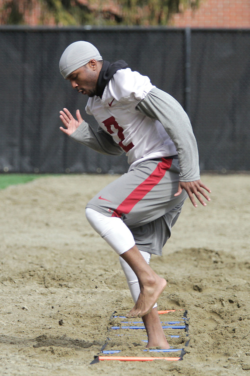 "Nolan Washington works in ""Leach Beach"" during a Spring football practice at Rogers Field at Washington State University under new head football coach, Mike Leach, on March 24, 2012."