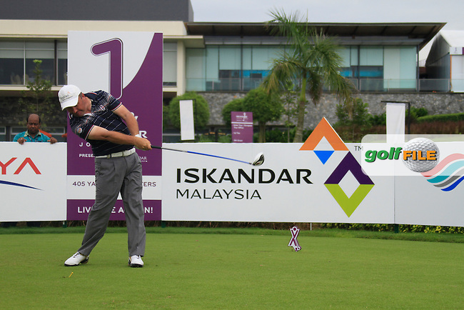 Damien McGrane (IRL) tees off on the 1st tee to start his match during Friday's Round 2 of the 2011 Iskandar Johor Open, Horizon Hills Golf Club, Johor, Malaysia, 18th November 2011 (Photo Eoin Clarke/www.golffile.ie)