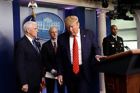 United States President Donald J. Trump leaves after a press briefing on the Coronavirus COVID-19 pandemic with members of the Coronavirus Task Force at the White House in Washington on March 19, 2020.  From left to right: US Vice President Mike Pence; Stephen Hahn, Commissioner, US Food and Drug Administration (FDA); President President Donald J. Trump; and US Surgeon General Vice Admiral (VADM) Jerome M. Adams, M.D., M.P.H.<br /> Credit: Yuri Gripas / Pool via CNP/AdMedia