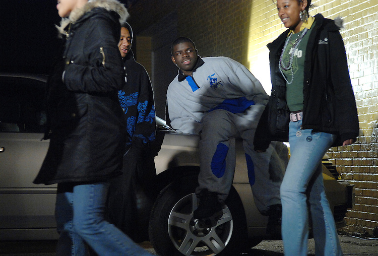 Lamar Brennon, 17, left, and Kenny Johnson, lean on a car while shooting a scene at the Multimedia Training Institute on W Street, Northeast.  The scene involved in two guys trying to pick up some girls that walked by.